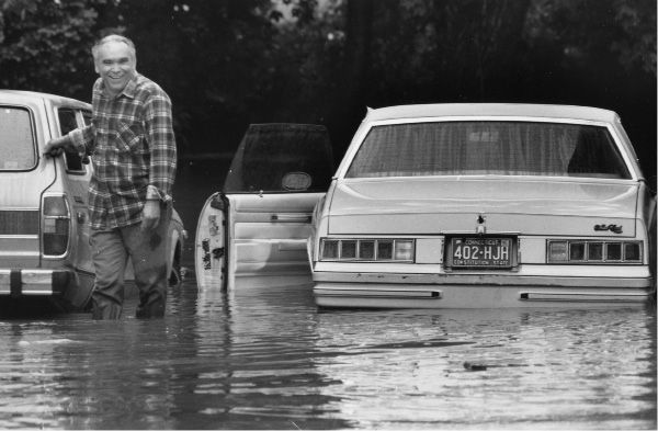 File photo - Ruben Lorenzo walks away from his car in his driveway on Cook Avenue in the 300 block after inspecting damage, June 6, 1992.