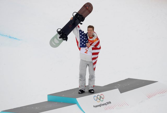 Shaun White, of the United States, celebrates his gold medal after the men