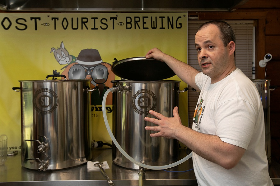 Gary Krock, owner of Lost Tourist Brewing, talks about the brewing process  Monday at his Meriden residence. Dave Zajac, Record-Journal