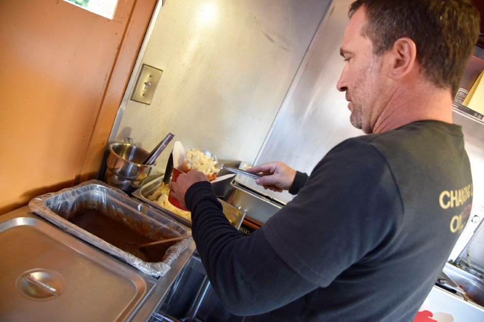 Kris Barletta makes poutine on his Poutine Gourmet food truck at the Apple Harvest Festival in Southington, on Oct. 4, 2019. | Bailey Wright, Record-Journal