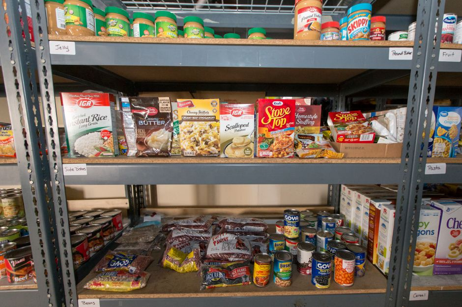 Donations of food fill the shelves Tuesday at Master