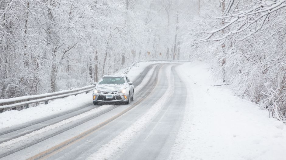 A vehicle drives on Durham Road in Wallingford during Tuesday's snow storm on March 13, 2018. | Devin Leith-Yessian / Record-Journal