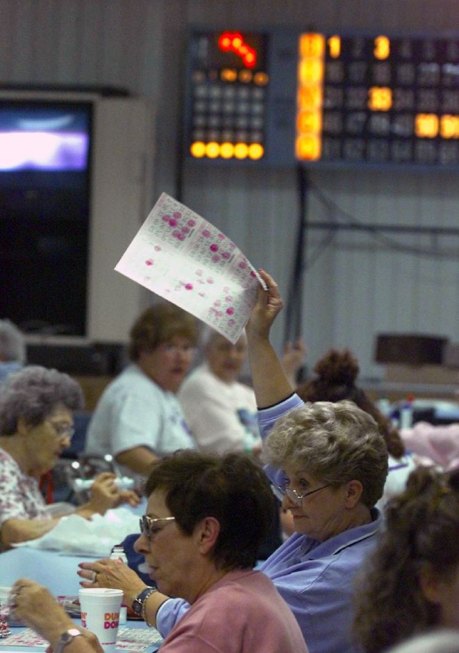 RJ file photo - Connie Casserino holds up her winning bingo card Thurs., June 10, 1999 at Our Lady of Mount Carmel.