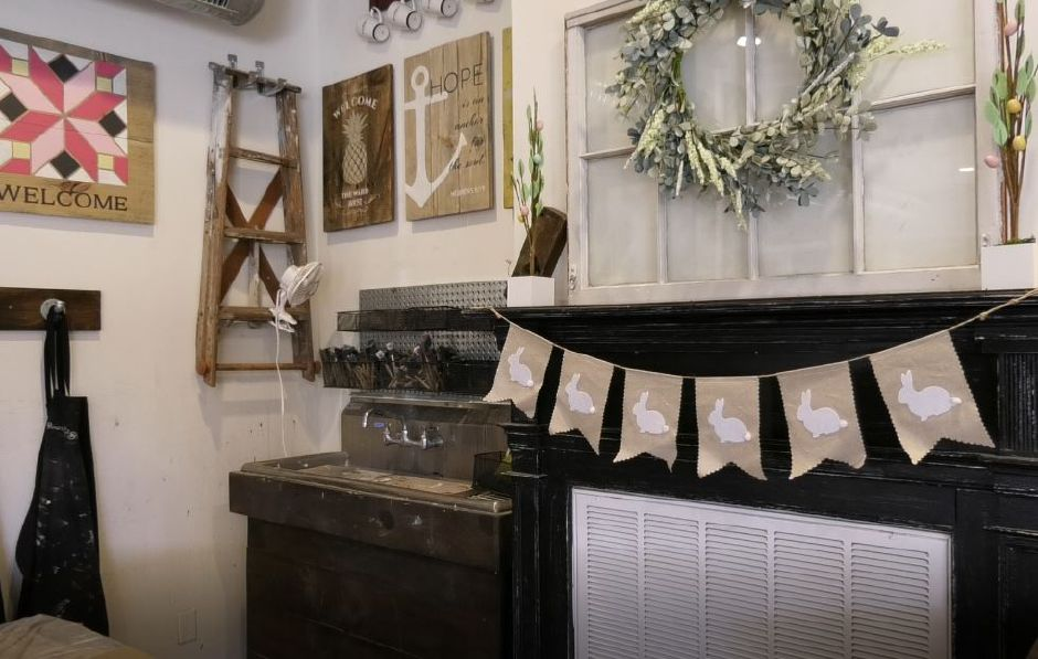 An Easter banner hangs on a mantle at Board & Brush Creative Studio, 61 Center St., Southington. |Ashley Kus, Record-Journal