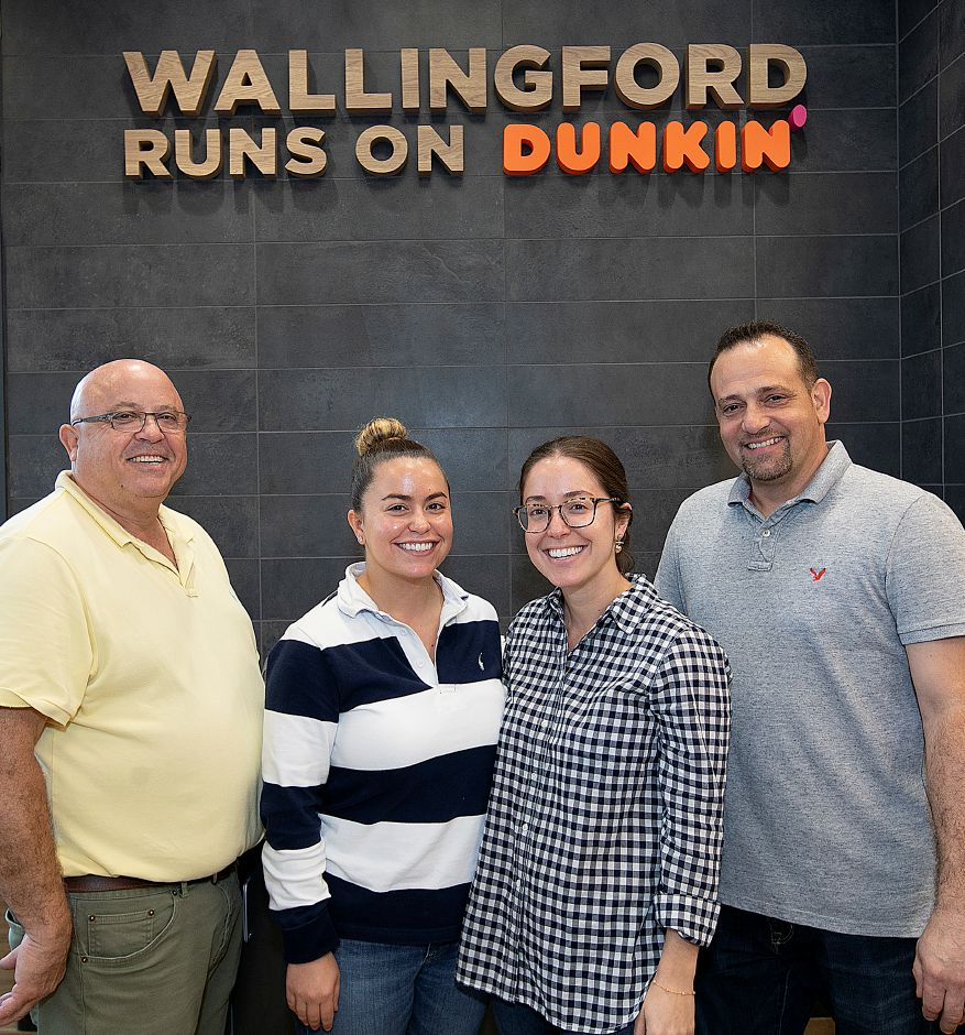 Left to right, Manny Rocha, owner, with daughters Erin Rocha, franchisee, Erica Rocha, franchisee and nephew, George Medeiros, director of operations, at the newly renovated Dunkin