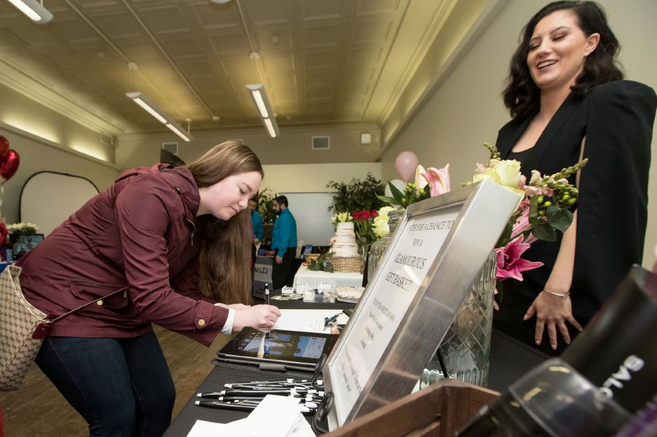 Kaelyn Audette of Wallingford registers for a drawing at Salonathaniel Saturday during the second annual Bridal Expo at the Hubcap in Wallingford February 16, 2019 | Justin Weekes / Special to the Record-Journal