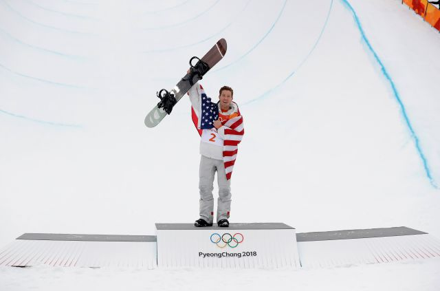 Gold medal winner Shaun White, of the United States, celebrates after the men
