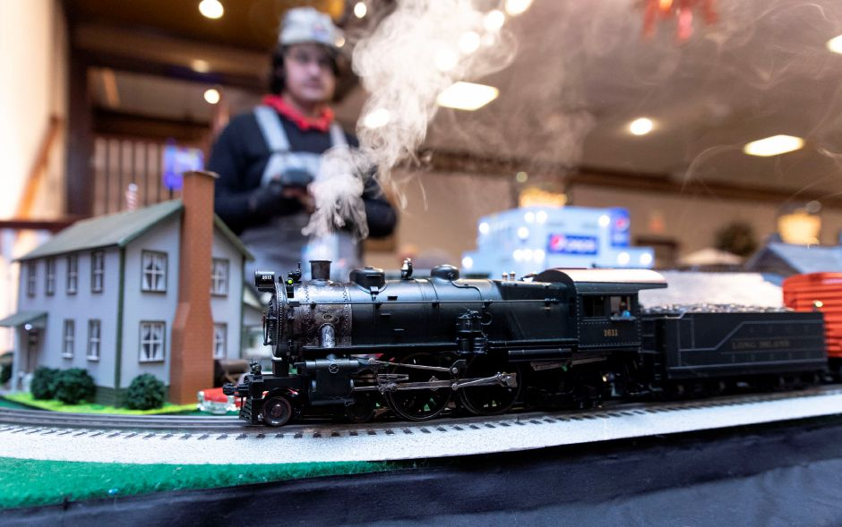 Riley Webb, 17, of Stratford, controls an electric model train.