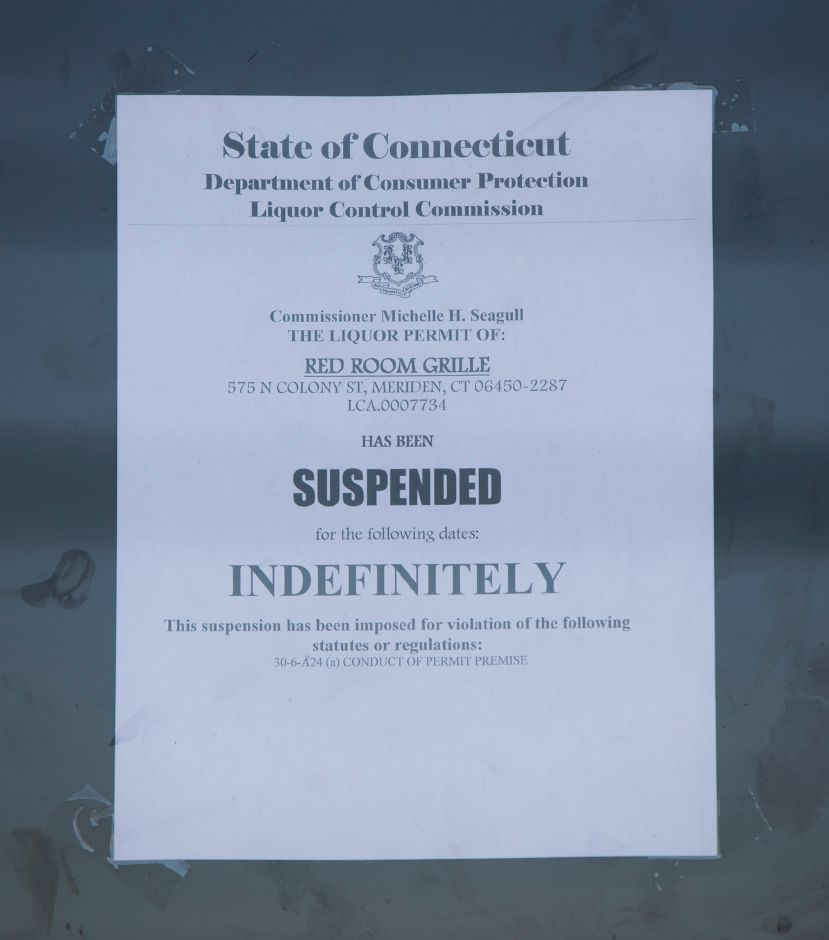 FILE PHOTO: A suspension posted on the front door of Red Room Grille on North Colony Street in Meriden, Tuesday, Nov. 21, 2017. The state Department of Consumer Protection has issued the business a summary suspension after a man was injured in a shooting at the establishment early Saturday. | Dave Zajac, Record-Journal