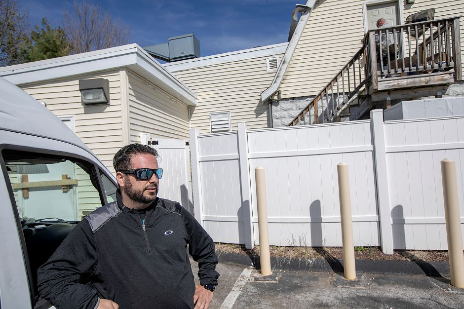 Massimo Riccitelli, of Southington, talks about fire damage to Mamma Mia Restaurant, 1765 Meriden-Waterbury Turnpike, Southington, on Wednesday. The restaurant is closed after a blaze Tuesday night. Riccitelli is a family friend of the restaurant owners.