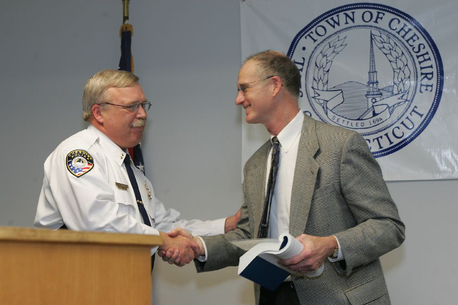 Cheshire Police Chief Chris Loudon, left, shakes hands with during his swearing in ceremony November 17, 2005. Chris Angileri/Record-Journal.
