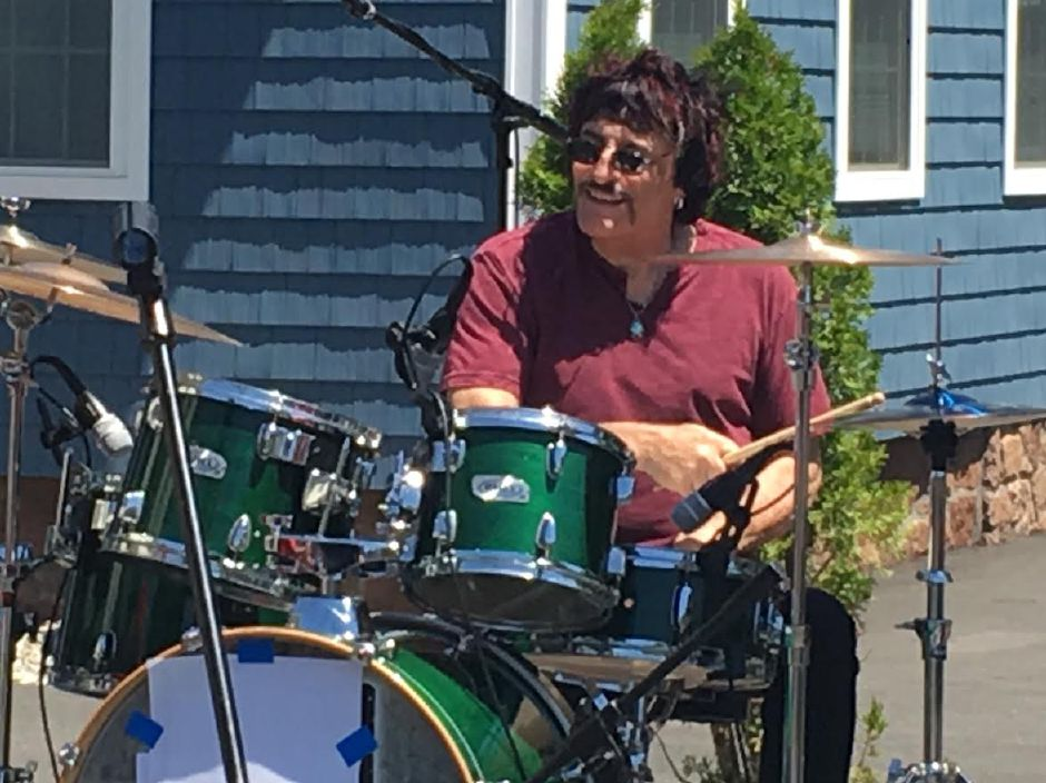 Carmine Appice, rock drummer and author of a popular instructional book on rock drumming, performs at the Rock House School of Music grand opening celebration in Wallingford, June 15, 2019. | Lauren Takores