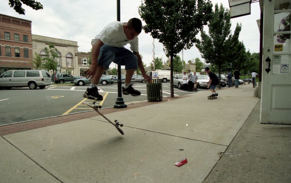 Tony Grico, 14, does a trick on his skateboard at Simpson Court in Wallingford on Sept. 25, 1996. Grico and his friends were  banned from skateboarding or skating in the downtown area under the provisions of a measure passed by the Town Council. About 15 teens skated, skateboarded and bicycled around downtown in an informal protest. File photo, Record-Journal