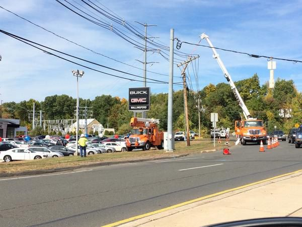 FILE PHOTO -- Crews from the Wallingford Electric Division work to repair a utility pole and restore power in the area of Route 5 in Wallingford, Friday, Oct. 10, 2014. (Eric Vo l Record-Journal)