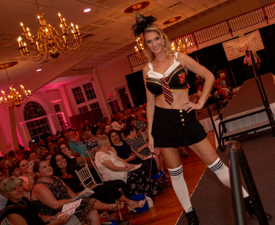 "Bethany Ty wears the Harry Potter themed ""Griffindore House Cups"" during the Art Bra 2018 Runway Show and Auction Aug. 9, 2018 at the Aqua Turf in Southington. 