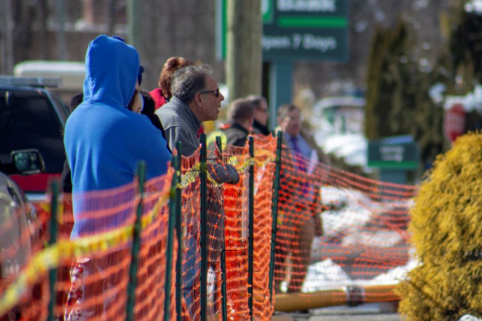 John Salerno, a Tops Marketplace owner, leans over the orange fencing to watch crews going through the remnants of Tops Marketplace in Southington March 4, 2019. | Richie Rathsack, Record-Journal