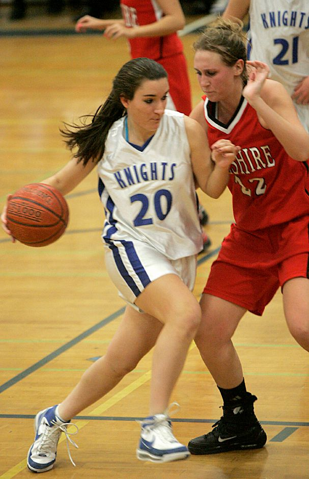 Record-Journal Photo/ Johnathon Henninger 12.29.2008 - Southington Lady Knight, Melissa Augustyn moves with the ball past Cheshire Ram, Emily Thomas at the 2008 Holiday Classic at Southington High School Monday night.