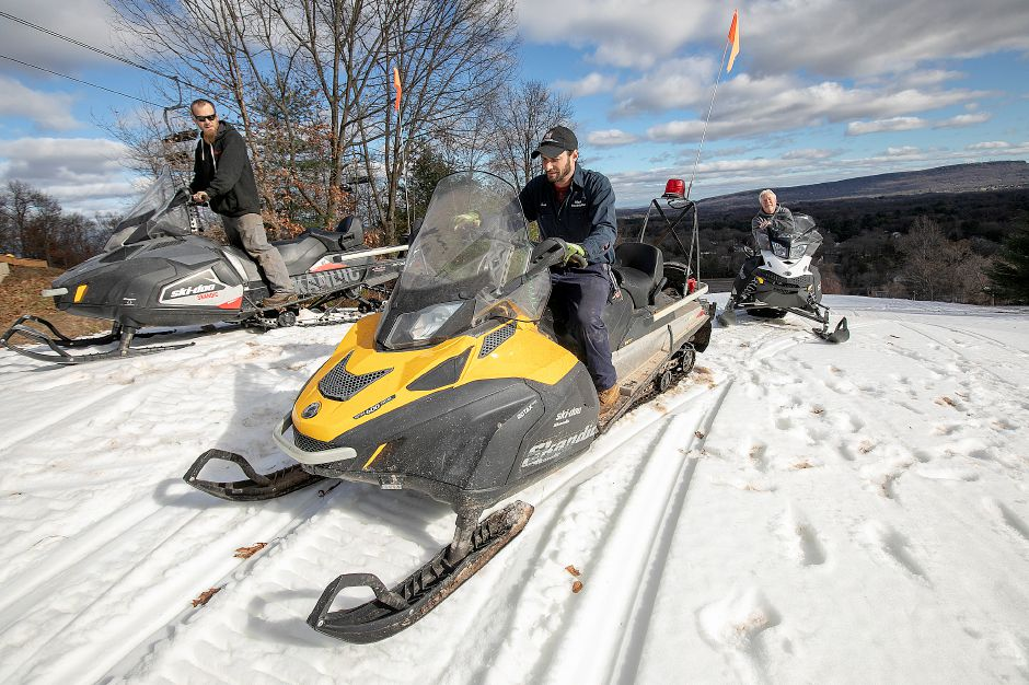 Left to right, Shane Riley, snow-making supervisor, Josh Wilensky, lift mechanic, and Duane Bass, general manager, use snowmobiles to help manage the trails at Mount Southington, Thurs., Nov. 29, 2018. Dave Zajac, Record-Journal