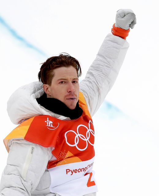 Shaun White, of the United States, celebrates after his run during the men
