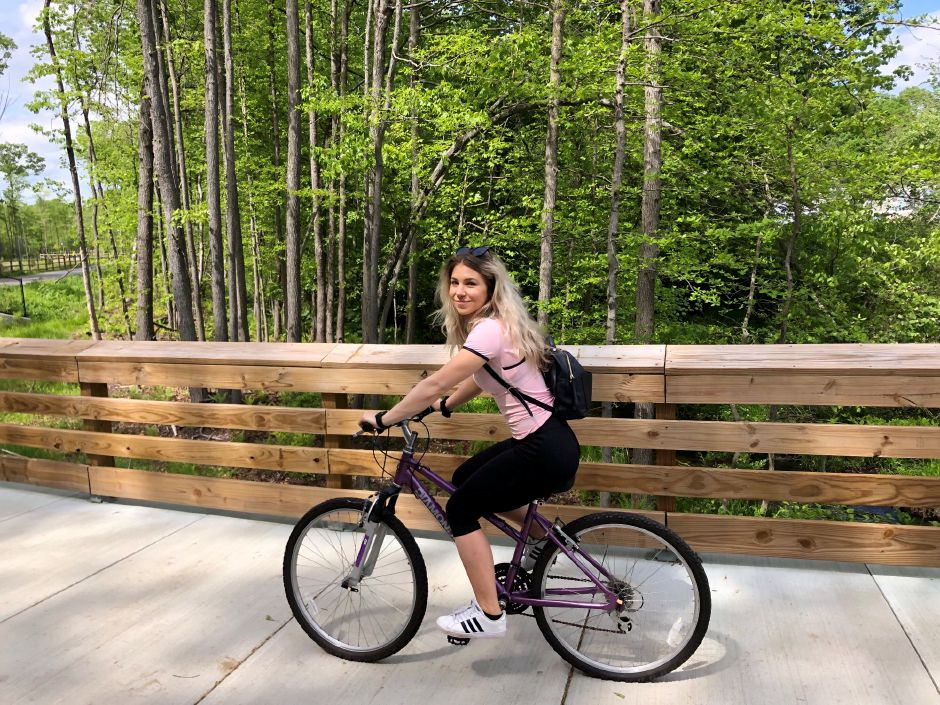 Kristen Dearborn biking along the Farmington Canal Heritage trail. | Kristen Dearborn, Contributed