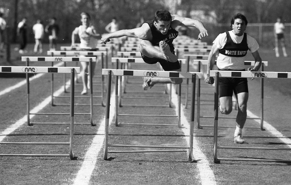 RJ file photo - Ed Nielander surges to victory in the 110-meter high hurdles for one of his four wins, April 1989.