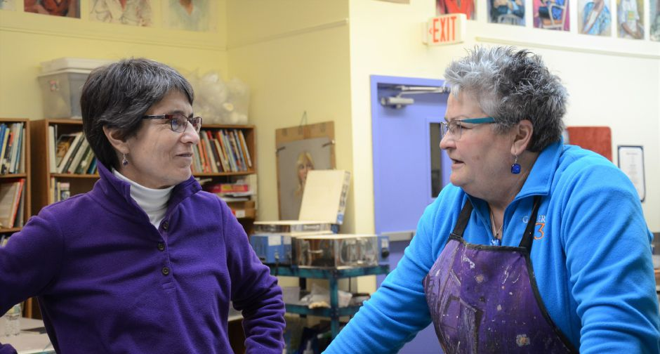 Andrea Stelma (left) talks to instructor Christine Webster (right) Tuesday night at Gallery 53's fused glass jewelry class.