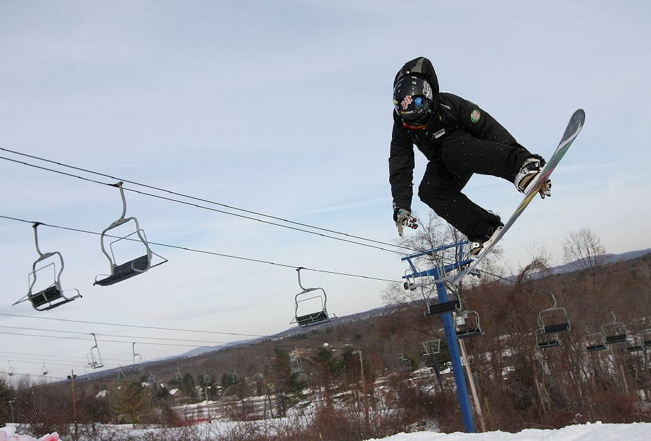 Mount Southington Snowboard Instructor Scott Marciniec, 17, of Southbury, practices his freestyle tricks in the terrain park at Mount Southington Ski Area in Southington on Thursday January 20, 2011. Marciniec had several lessons set up once school got out later in the afternoon. (Matt Andrew/ Record-Journal)