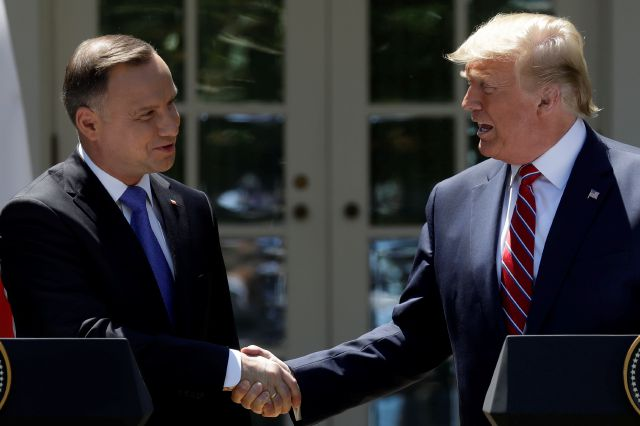 President Donald Trump shakes hands with Polish President Andrzej Duda during a news conference in the Rose Garden of the White House, Wednesday, June 12, 2019, in Washington. (AP Photo/Evan Vucci)