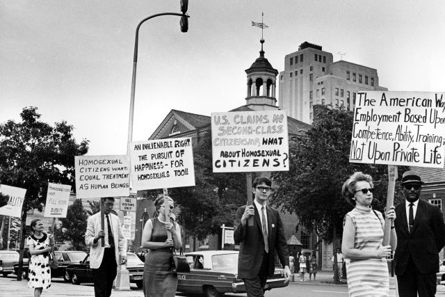 FILE - In this July 4, 1967 file photo Kay Tobin Lahusen, right, and other demonstrators carry signs calling for protection of homosexuals from discrimination as they march in a picket line in front of Independence Hall in Philadelphia. In 2019, same-sex marriage is the law of the land in the U.S. and at least 25 other countries. LGBT Americans serve as governors, big-city mayors and members of Congress, and one _ Pete Buttigieg _ is waging a spirited campaign for president. (AP...