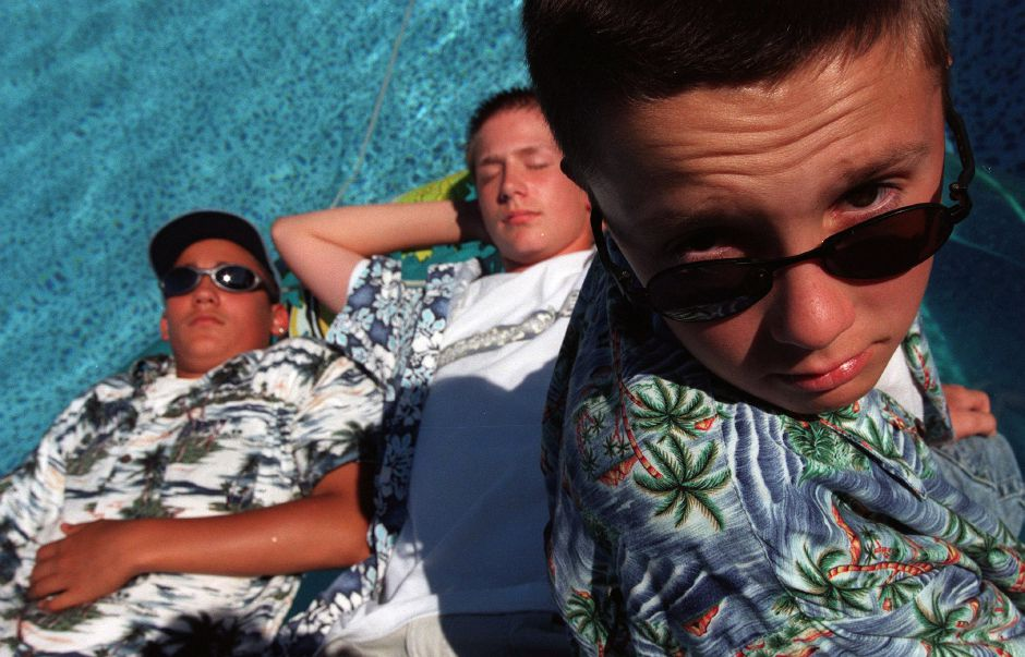 RJ file photo - David Mojica, 13, left, Eric Belange, 14, middle, and Brad Bateman, 12, right, all like to wear Hawaiian shirts. Eric and Brad are step brothers. They are in the pool at their Meriden home June 10, 1999.
