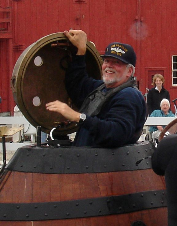 Roy Manstan emerges from a full-scale replica of the Revolutionary War submarine, TURTLE, after tests conducted at Mystic Seaport.