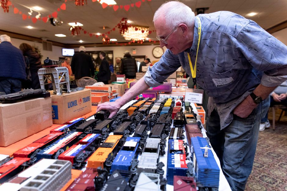 David Lewis, of Brookfield, looks at model trains being sold by Paul Cirillo, of Rhode Island.