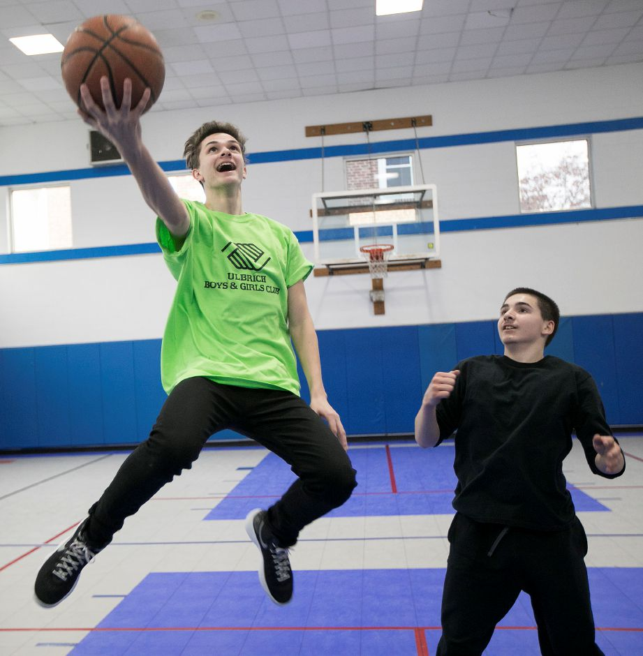Ezra Gaydos, 17, of Wallingford, left, takes a shot next to, Brandon Gambardella, 14, of Wallingford, during a game of one on one at the Ulbrich Boys and Girls Club in Wallingford, Friday, February 9, 2018. Gaydos has been named Youth of the Year for Ulbrich Boys and Girls Club. Dave Zajac, Record-Journal