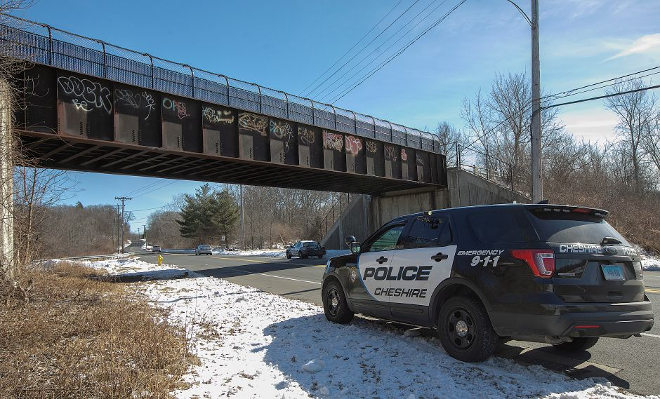 "Police investigate an ""untimely death"" on the Farmington Canal Heritage Trail south of the West Johnson Avenue pedestrian bridge, Tuesday. Dave Zajac, Record-Journal"
