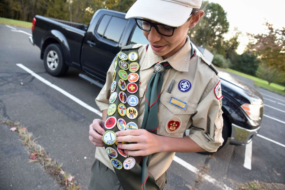 Coginchaug High School sophomore Jacob Fazzino shows off some of the badges he