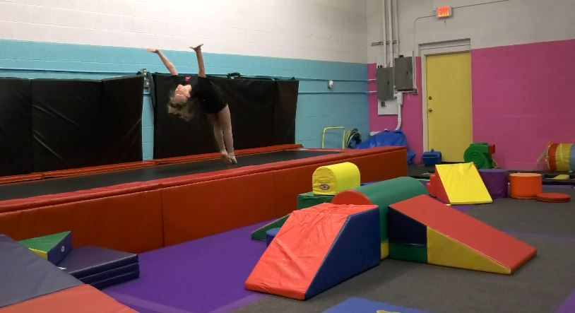 Meghan Lund, 15, does a back handspring in the new gymnastics room at Fusion Fitness & Dance, a new location at 21 North Plains Industrial Rd., Wallingford, Nov. 26, 2018 |Ashley Kus, Record-Journal