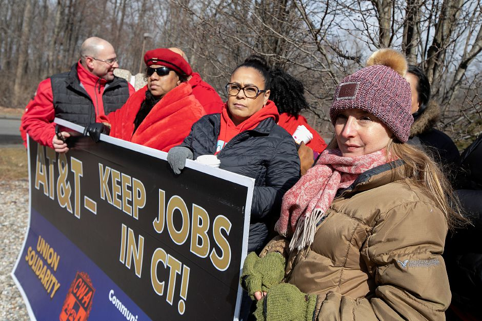 AT&T employee Lucia Coelho, of Prospect, right, stands with fellow workers impacted by the planned closure of several local AT&T call centers, Mon., Feb. 25, 2019. Dave Zajac, Record-Journal