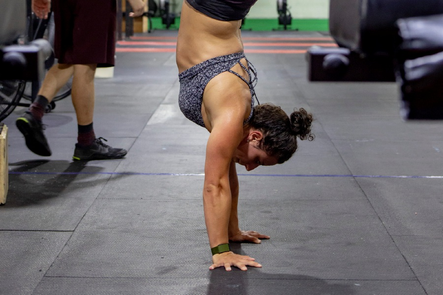 Meriden Crossfit coach Giana Ives does a handstand during a workout at the at the Cambridge Street facility.