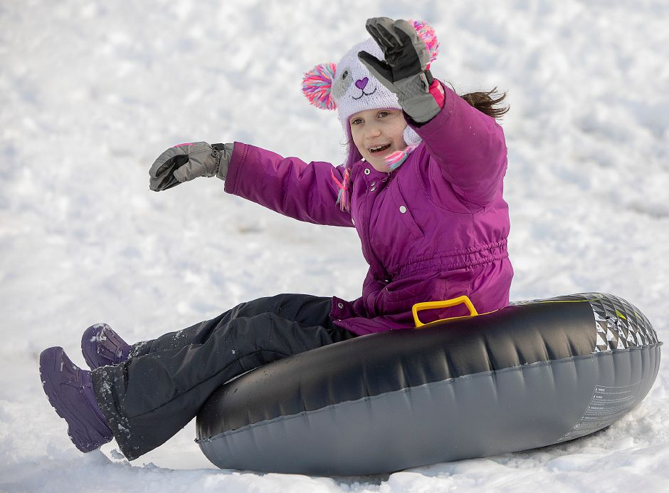 Ashlyn Aftowski, of Southington, tubes down a snow covered hill at Panthorn Park in Southington, Mon., Mar. 4, 2019. An overnight storm left about 10 inches of snow in the area. Dave Zajac, Record-Journal