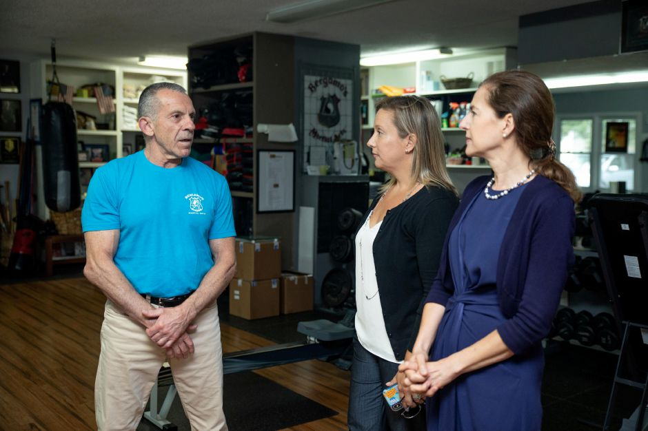 In this file photo, Ralph Bergamo, owner of Cheshire Martial Arts and Fitness, talks with State Rep. Liz Linehan, center,  and Lt. Gov. Susan Bysiewicz. File photo, Record-Journal
