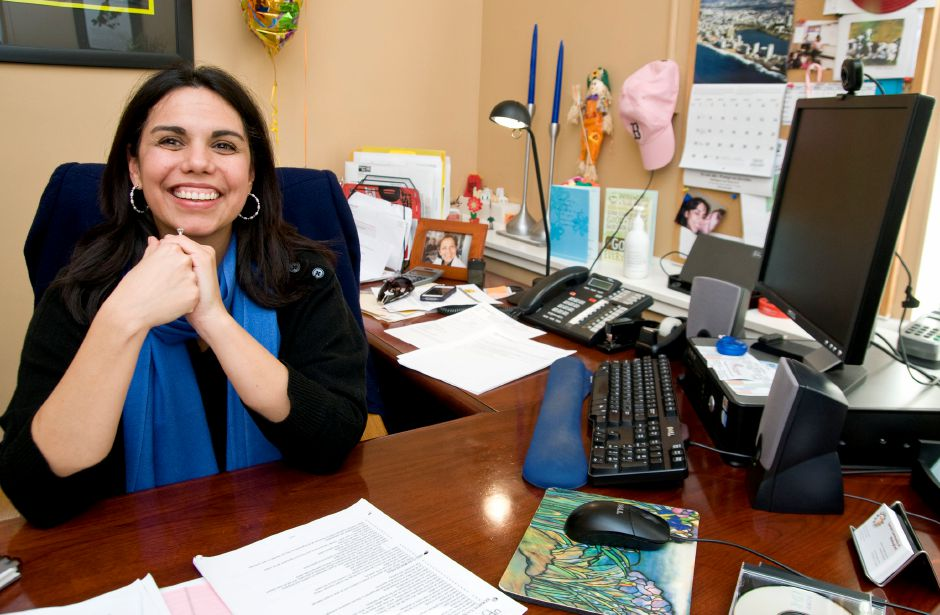 FILE PHOTO – Maria Campos-Harlow, Executive Director of the Spanish Community of Wallingford, sits for a portrait in her office on Washington Street in Wallingford, January 25, 2012. 2012 marks the 40th anniversary of SCOW and Campos-Harlow said they credit part of their success to the strong relationship they have with the town of Wallingford at large. (Sarah Nathan/Record-Journal)