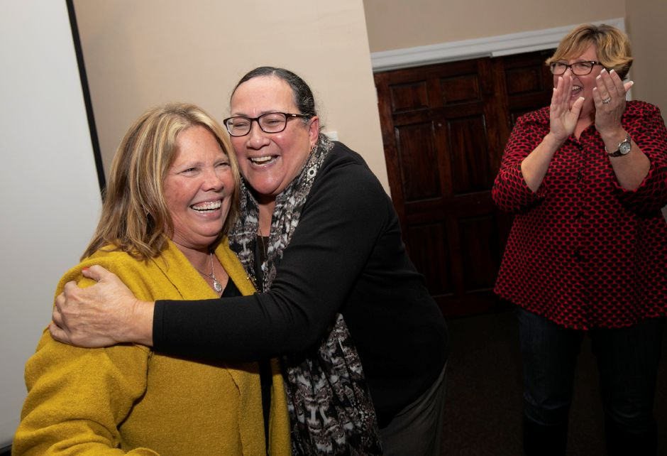 Mary Daugherty Abrams (D) hugs Hilda Santiago (D) after winning the 13th Senate District in the 2018 midterm elections in Meriden, Tues., Nov. 6, 2018. Dave Zajac, Record-Journal