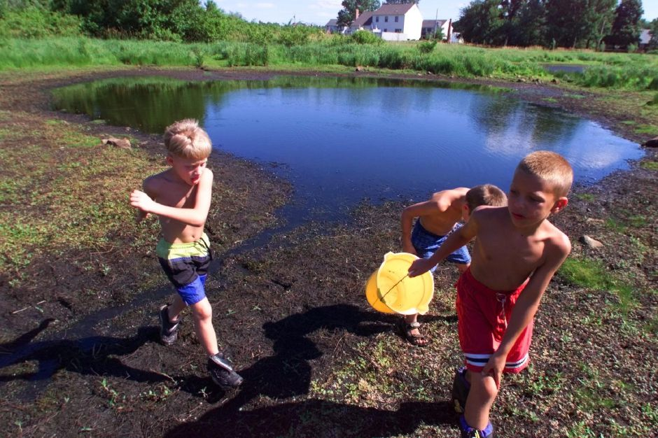 Bucket in hand and ankle deep in mud , Cody Buntin (cq),7, leads friend Justin Girard Jennings,6, Harvey Jennings III and Cody