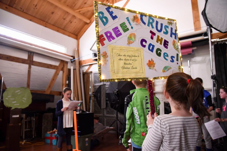 Third-grader Daphne Liss, of Durham, holds a light-up sign as part of her role in the Coginchaug Valley Education Foundation Odyssey of the Mind team, during their practice in Middlefield on April 30, 2019. | Bailey Wright, Record-Journal