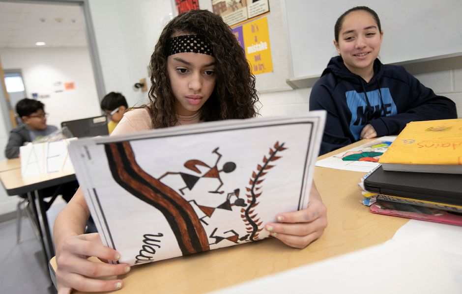 Danielys Cruz, 11, left, looks over artwork sent from a student in India next to student Ariel Dorsey, 11, right, during their sixth grade class at Lincoln Middle School in Meriden, Thurs., Mar. 14, 2019. The school is taking part in the Artlink program through Creative Connections, an International cultural education organization. Dave Zajac, Record-Journal