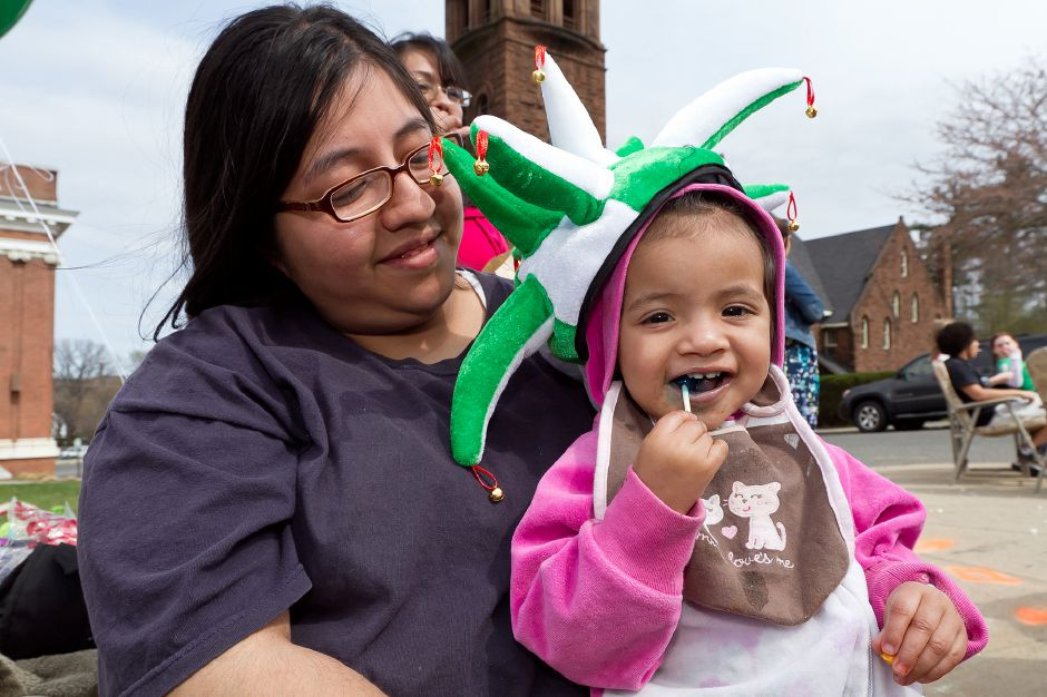 Cristina McNair sits with her 1-year-old daughter, K.C. McNair, watching the St. Patrick