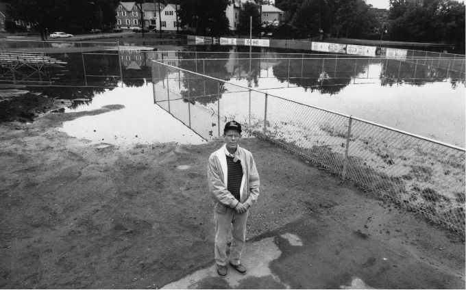 File photo - Bill Happ, president of the little league in Meriden stands guard at the North End fields, which were flooded due to the rain June 6, 1992.