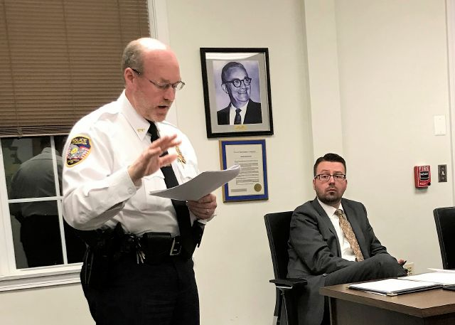 FILE - In this Nov. 14, 2018 file photo, East Hampton, Conn., Police Chief Dennis Woessner addresses the Town Council in East Hampton. East Hampton officer Kevin P. Wilcox, has retired from the force after Committee for Civil Rights Under Law raised concerns about his membership with the Proud Boys, a far-right group known for engaging in violent clashes at political rallies. In September, Woessner told the civil rights organization that Wilcox's Proud Boys membership didn't violate...
