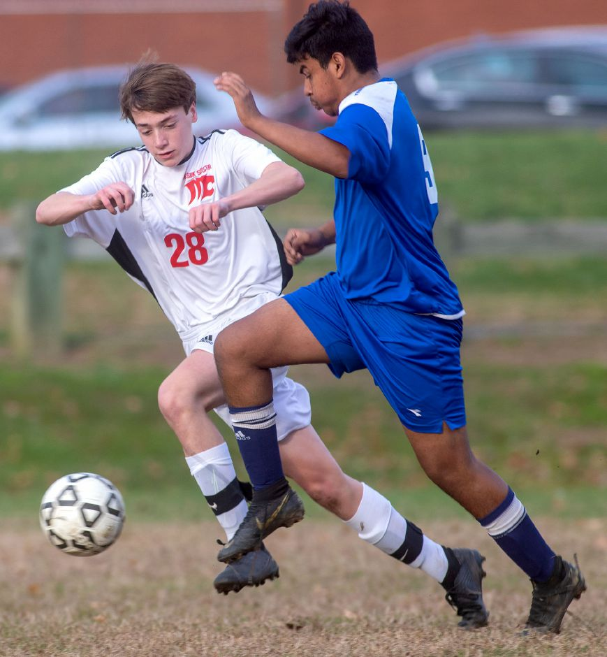 Wilcox Tech's Giovanny Solis  dribbles past Masuk's Scott Mastrorocco during the first round of the CIAC Class L boys soccer tournament at Wilcox Tech on Monday. Wilcox Tech lost 2-0. Aaron Flaum, Record-Journal