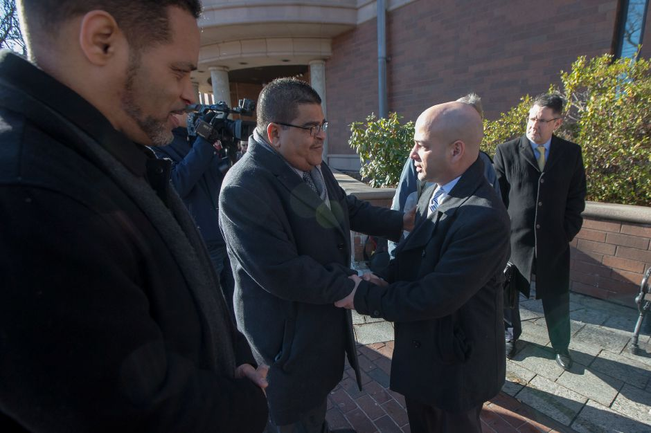 Rev. Victor Gomez of East Haven greets Meriden Councilman Miguel Castro after his arraignment Thursday at the Superior Court in Meriden December 27, 2018 | Justin Weekes / Special to the Record-Journal